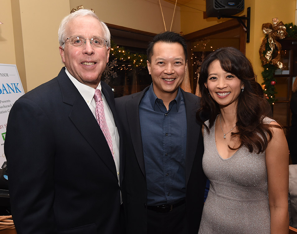 Philip Perskie, chairman of Bacharach's board of governors, with Alvin Ong, M.D. and his wife, Sulin Yao, M.D.